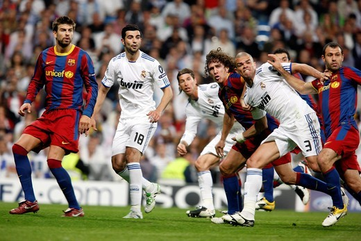 Group of players looking at the ball after a free kick, UEFA Champions League Semifinals game between Real Madrid and FC Barcelona, Bernabeu Stadiumn, Madrid, Spain : Stock Photo