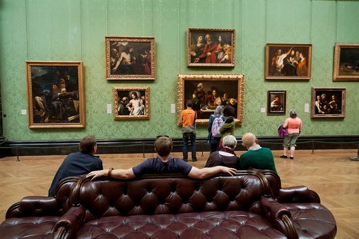 viewing paintings including The Supper at Emmaus by Caravaggio in the Italy section of the National Gallery, london : Stock Photo