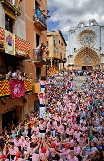 Stock Photo: 1566-851701 Xiquets de Tarragona ´Castellers´ human tower walking, a Catalan tradition Festa de Santa Tecla, city festival  Carrer Major Tarragona, Spain