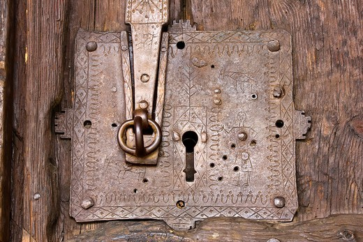 Stock Photo: 1566-854202 Romans decorated wrought iron lock with human figures and geometric patterns in the Church of the Nativity of Durro - Boi - Vall de Boi - Lleida - Catalonia - Cataluña - Spain - Europe