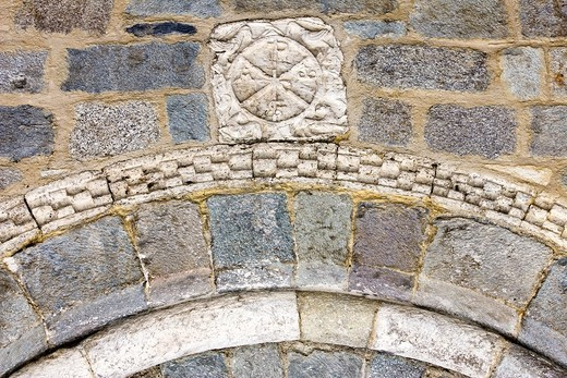 Chi-Rho on the cover of the Romanesque church of the Nativity of Durro - Vall de Boi - Pyrenees - Lleida Province - Catalonia - Spain : Stock Photo