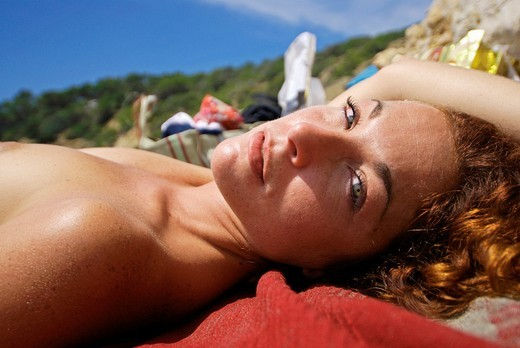 Stock Photo: 1566-859836 Attractive red haired girl enjoying the beach, Ibiza, Spain