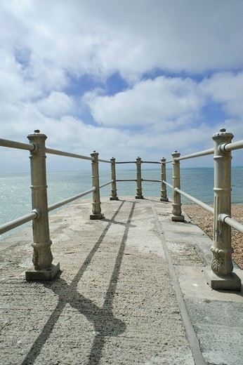 Small fenced pier on the beach at Hastings, East Sussex, England  UK : Stock Photo