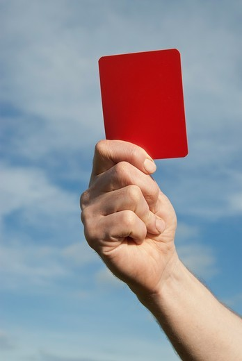 Referee waving a red card : Stock Photo