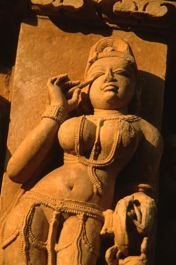 Stock Photo: 1566-860866 India, Madhya Pradesh, Khajuraho, stone carvings on temples,