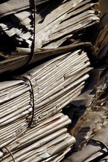 pile of old used newspapers left in street road in city town : Stock Photo