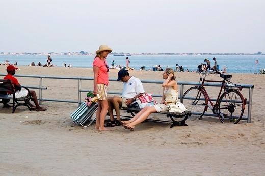 Stock Photo: 1566-862639 People sitting on the bench near beach, Boardwalk, Brighton Beach, Brooklyn, New York - City, state of New York, United States, USA