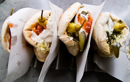 Falafels with salad covered with Tahini sauce in a pita bread is Israel´s & Palestine´s national street food. : Stock Photo