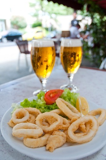 Fried squids serving. Madrid, Spain. : Stock Photo