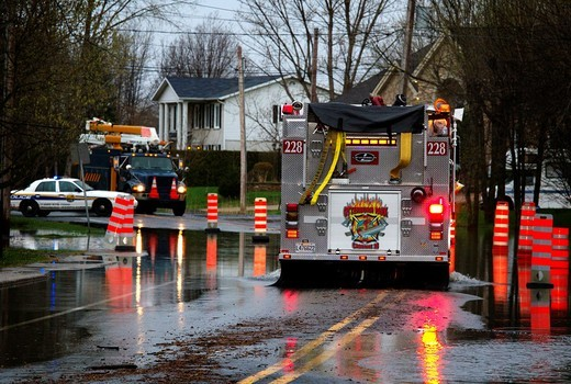 Firetrucks arriving on scene of flooded road, Richelieu River flooding, Beloeil, Quebec, Canada 2011 : Stock Photo