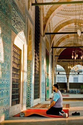 Stock Photo: 1566-865655 Man praying in Rustem Pasha Mosque Istanbul, Turkey