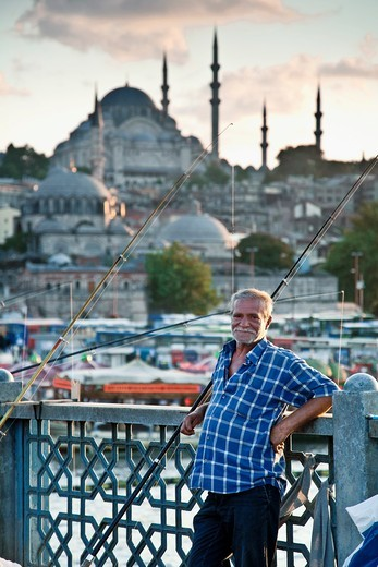 Stock Photo: 1566-865677 Angler in Galata Bridge  Istanbul, Turkey