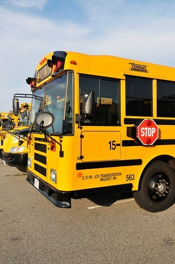 Stock Photo: 1566-865928 Front of yellow school buses parked in line i storage durning summer vacation, USA