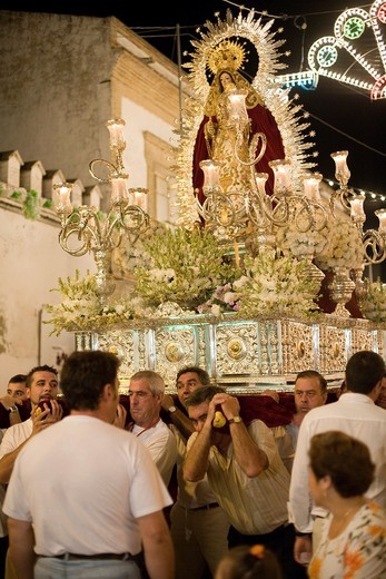 Men bearing a float with the Virgin image, Castilleja del Campo, Spain : Stock Photo