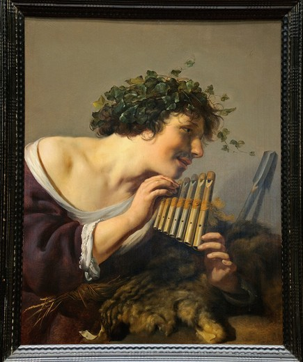 Shepherd Playing Panpipes, by Johannes Moreelse, Dutch, Oil on wood, 28 3/4 x 22 3/4 in , 73 x 57 8 cm, Metropolitan Museum of Art , New York City : Stock Photo