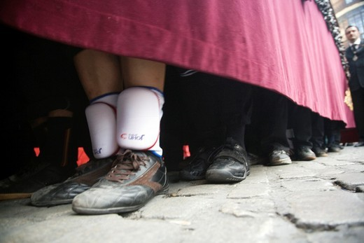 Feet of float bearers during a Holy Week procession, Seville, Spain : Stock Photo