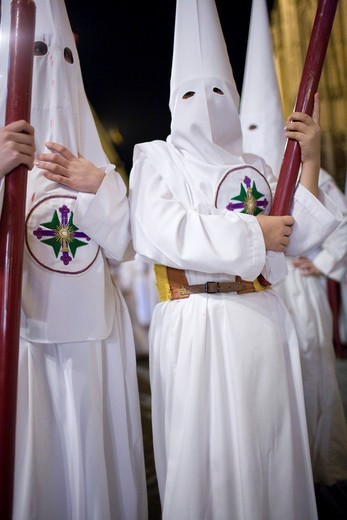 Young penitents bearing candles, Holy Week, Seville, Spain : Stock Photo