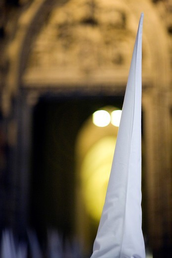 Hooded penitent entering Seville´s cathedral, Holy Week, Spain : Stock Photo