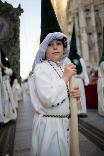 Young penitent with raised hood : Stock Photo