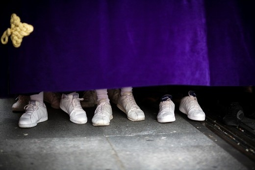 The feet of costaleros or float bearers, Holy Week 2008, Seville, Spain : Stock Photo