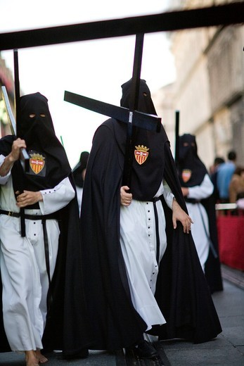 Stock Photo: 1566-867919 Hooded penitents bearing wooden crosses, Holy Week 2008, Seville, Spain