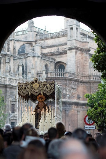 Stock Photo: 1566-867926 Framed view of a Holy Week float with the Virgin image in front of Seville´s Cathedral, Spain