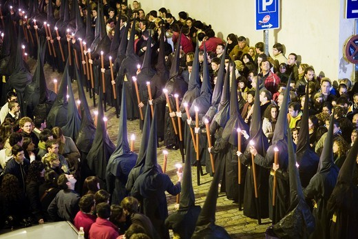 Stock Photo: 1566-867929 Hooded penitents bearing candles on Good Friday, Seville, Spain