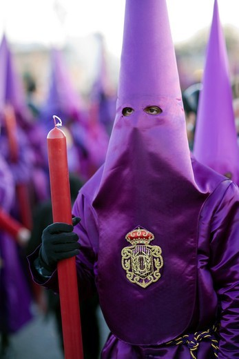 Penitent bearing candle, Good Friday, Seville, Spain : Stock Photo