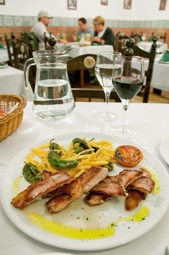 Iberian secret serving, typical Iberian pork steak. Spain. : Stock Photo