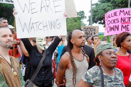 Florida, Miami, Biscayne Boulevard, Freedom Torch, Occupy Miami, demonstration, protest, protesters, anti Wall Street, banks, corporate greed, sign, poster, message, 99, holding, Black, woman, man, mask, : Stock Photo