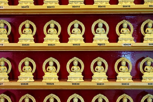 Numbered golden statues of Buddha while meditating in lotus position  Singapore Buddha Tooth Relic Temple and Museum : Stock Photo