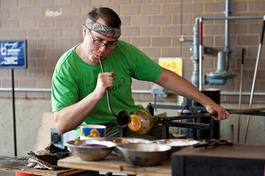 Glass blower giving a demonstration in the Hot Shop at the Franklin Park Conservatory in Columbus, Ohio : Stock Photo
