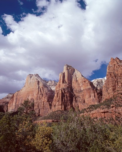 Cumulus clouds drift over the Three Patriarchs with Mt Abraham left, Mt Isaac center and Mt Moroni right, Zion Canyon, Zion National Park, Utah, USA : Stock Photo