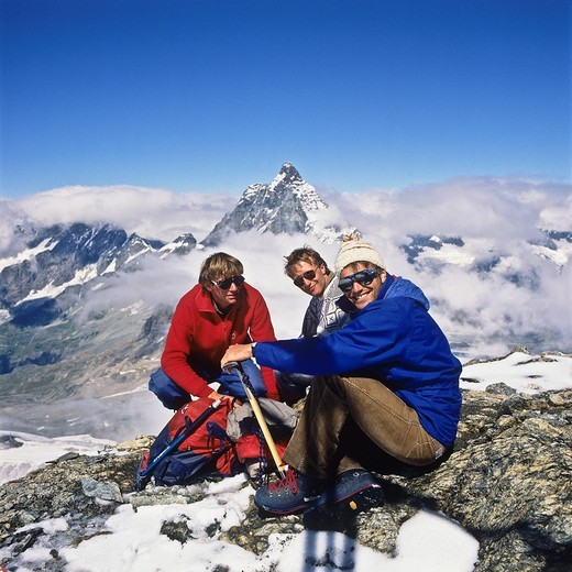Stock Photo: 1566-872251 3 alpinists in front of the top of the Matterhorn, Zermatt, canton Valais, Switzerland