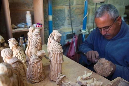 Israel, West Bank, Bethlehem, Arab Christian artisan making wooden religious figures, R, MR-ISL-11-003 : Stock Photo