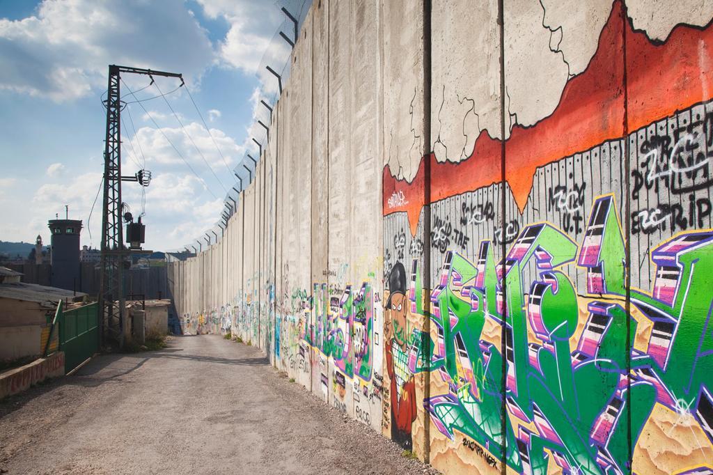 Israel, West Bank, Bethlehem, Israeli-built West Bank Wall surrounding Bethlehem : Stock Photo