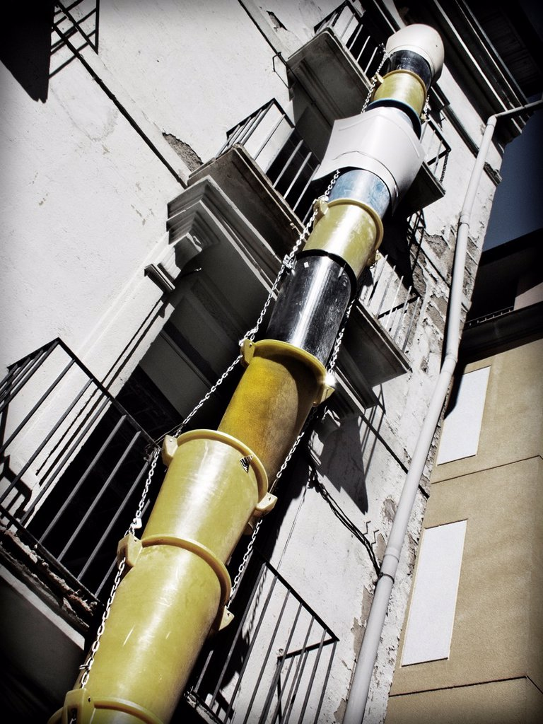 Stock Photo: 1566-873878 Facade of apartment building with discharge pipes of debris.