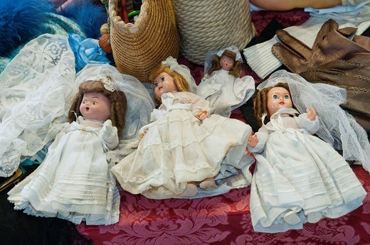 Stock Photo: 1566-874359 Vintage somewhat scary puppet toys at an antique shop, Spain