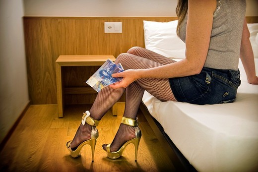 Prostitute in a hotel room, Canton Ticino, Switzerland : Stock Photo