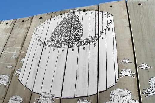 A banksy graffiti on the separation wall, Bethlehem, Palestine : Stock Photo