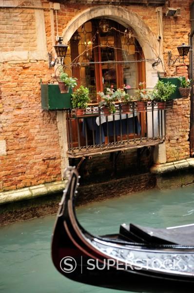 Stock Photo: 1566-877628 Italy,Veneto,Venice,front of gondola passing