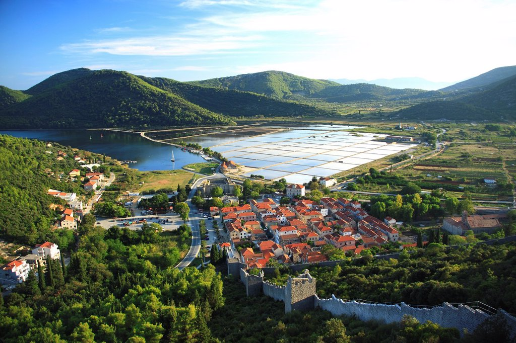 Town of Ston known for salt production, salt pans in the background, Peljesac peninsula, Croatia : Stock Photo