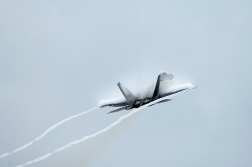 Stock Photo: 1566-878772 Modern & stealth american jet fighter F-22A Raptor climbing at high speed, Elmendorf Air Force base, Anchorage, Alaska, Usa