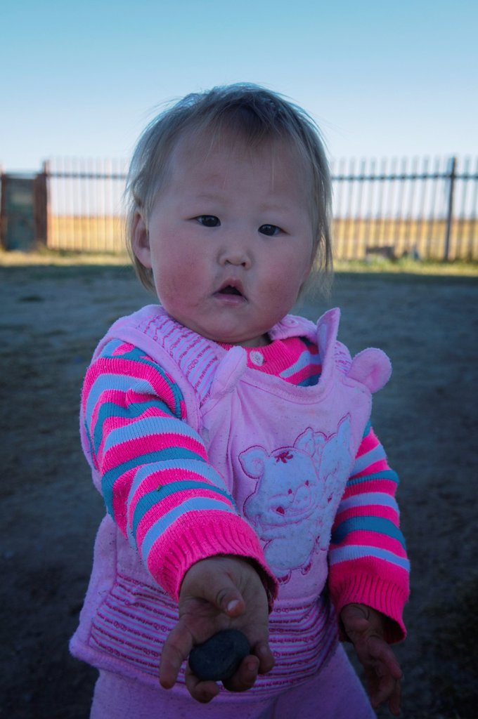blond Mongolian baby in the Orkhon River Valley of Central Mongolia : Stock Photo