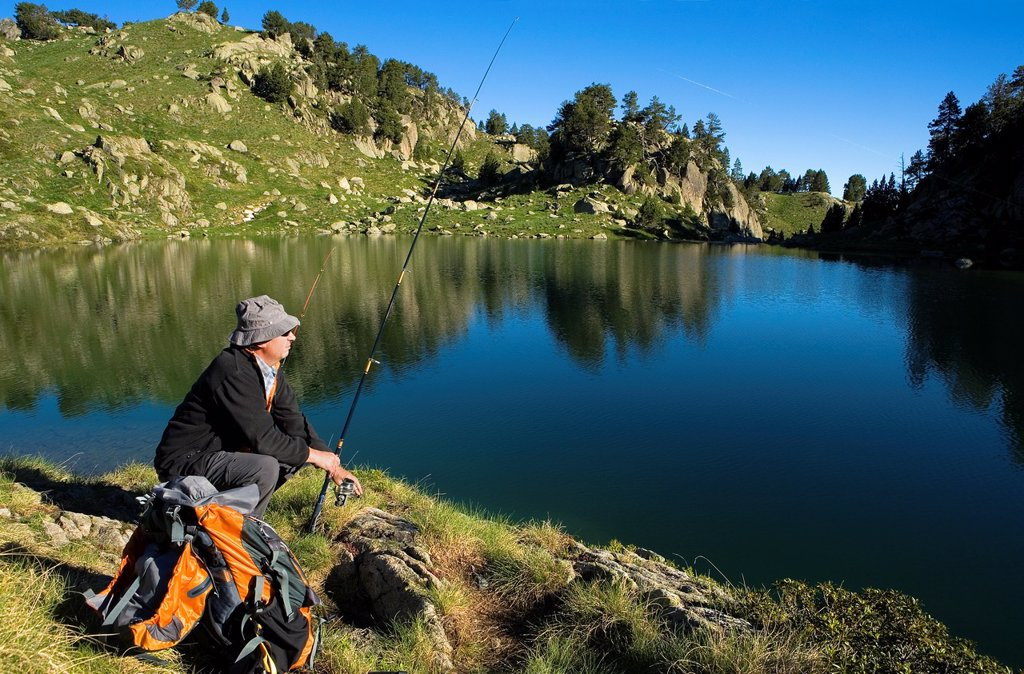 Stock Photo: 1566-881339 Estany Long, Fisherman,Colomèrs cirque,Aran Valley, Aigüestortes and Estany de Sant Maurici National Park,Pyrenees, Lleida province, Catalonia, Spain