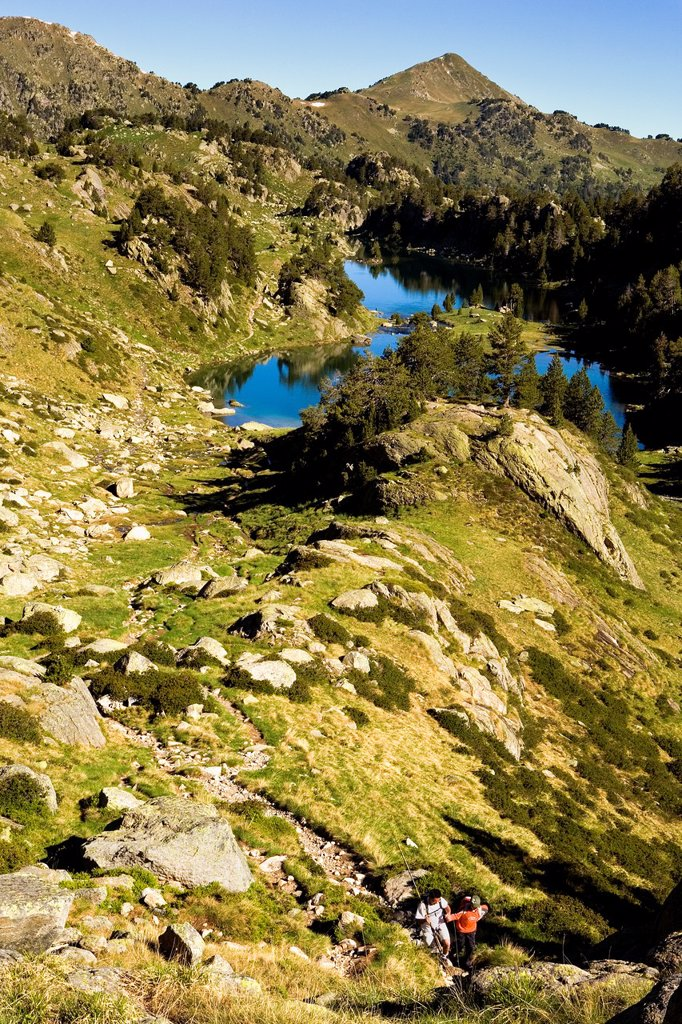 Trippers, in backgrond Redon and Long lakes,Colomèrs cirque,Aran Valley, Aigüestortes and Estany de Sant Maurici National Park,Pyrenees, Lleida province, Catalonia, Spain : Stock Photo