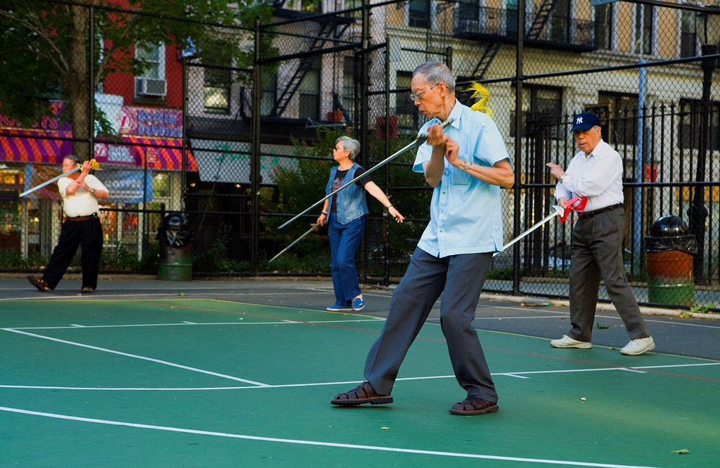 Chinese people performing early morning Sword exercises in Columbus Park,New York City, USA : Stock Photo