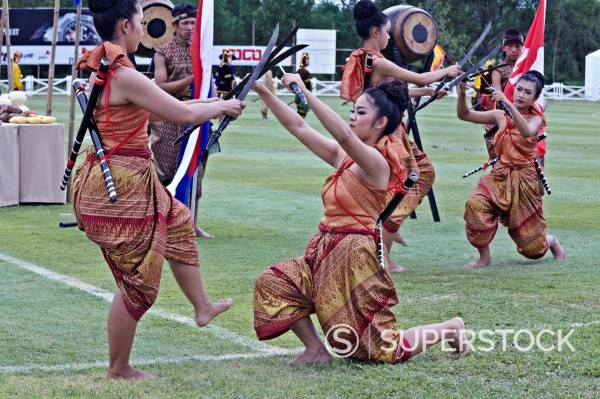 Stock Photo: 1566-881723 Thailand dancers open air exhibition involving sword fighting routine  Asia