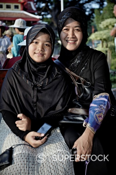 Stock Photo: 1566-881735 Muslim mother and daughter in traditional hijab headwear  Thailand Asia