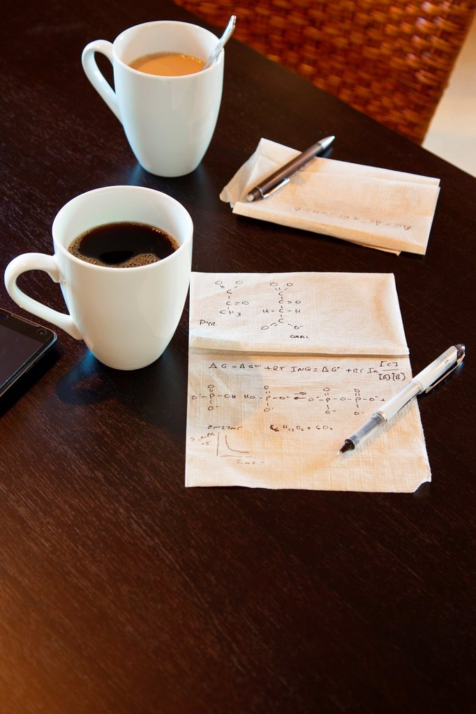 Stock Photo: 1566-884115 Molecular calculations on a paper napkin on a coffee shop table